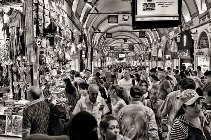 grayscale photo of people at market